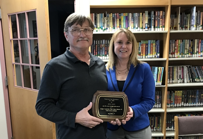 Mike Rice recognized for 16 years on Fisher School Board of Education.